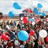 Students at Robin Hill School release balloons during a grand opening of the school\'s new playground in Norman, Oklahoma February 23, 2009. BY STEVE GOOCH, THE OKLAHOMAN.
