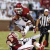 Oklahoma\'s Brennan Clay (24) carries during a college football game between the University of Oklahoma Sooners (OU) and the West Virginia University Mountaineers at Gaylord Family-Oklahoma Memorial Stadium in Norman, Okla., on Saturday, Sept. 7, 2013. Photo by Steve Sisney, The Oklahoman