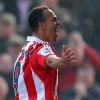 Photo - Stoke City's Peter Odemwingie, celebrates his goal,  during the English Premier League soccer match against Hull City, at the Britannia Stadium, Stoke On Trent, England, Saturday March 29, 2014. (AP Photo/PA,  Dave Thompson) UNITED KINGDOM OUT