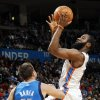Oklahoma City\'s James Harden (13) shoots over Jose Barea (11) during the NBA basketball game between the Dallas Mavericks and the Oklahoma City Thunder at the Oklahoma City Arena in Oklahoma City, Monday, Dec. 27, 2010. Dallas won, 103-93. Photo by Nate Billings, The Oklahoman