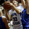 Photo - Deer Creek's Ashley Gibson goes to the basket between Harrah's Bailey Mack, left, and Blake Blessington during their girls basketball game in the Bethany Classic tournament at the Sawyer Center in Bethany, Friday, Jan. 11, 2013. Photo by Bryan Terry, The Oklahoman