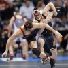 Oklahoma State\'s Joshua Kindig takes down Oregon State\'s Scott Sakaguchi in the 149 pound match during the 2014 NCAA Div. 1 Wrestling Championships at Chesapeake Energy Arena in Oklahoma City, Okla. on Friday, March 21, 2014. Photo by Chris Landsberger, The Oklahoman