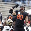 Oklahoma State\'s Cooper Bassett (80) celebrates a fumble recovery in front of Purdue\'s Tommie Thomas (12) during the Heart of Dallas Bowl football game between the Oklahoma State University (OSU) and Purdue University at the Cotton Bowl in Dallas, Tuesday,Jan. 1, 2013. Photo by Sarah Phipps, The Oklahoman