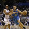 New Orleans Hornets power forward Ryan Anderson (33) drives around Orlando Magic\'s Arron Afflalo, left, during the first half of an NBA basketball game on Wednesday, Dec. 26, 2012, in Orlando, Fla. (AP Photo/John Raoux)