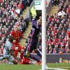 Photo - Liverpool's Martin Skrtel, second left, scores an own goal during their English Premier League soccer match against Newcastle at Anfield, Liverpool, England, Sunday, May 11, 2014. (AP Photo/Peter Byrne, PA Wire)     UNITED KINGDOM OUT     -    NO SALES    -    NO ARCHIVES