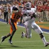 Oklahoma Sooners running back Damien Williams (26) scores a touchdown past UTEP Miners defensive back Drew Thomas (10) during the college football game between the University of Oklahoma Sooners (OU) and the University of Texas El Paso Miners (UTEP) at Sun Bowl Stadium on Sunday, Sept. 2, 2012, in El Paso, Tex. Photo by Chris Landsberger, The Oklahoman