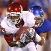 Oklahoma\'s Ryan Broyles (85) catches a pass in front of Kansas\' Tyler Patmon (33) during the college football game between the University of Oklahoma Sooners (OU) and the University of Kansas Jayhawks (KU) at Memorial Stadium in Lawrence, Kansas, Saturday, Oct. 15, 2011. Photo by Bryan Terry, The Oklahoman