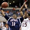 ST. MARY\'S, COLLEGE BASKETBALL: Saint Mary\'s Paul Marigney (11) rebounds against Tony Young (15) in the first round of the NCAA Tournament at the Ford Center in Oklahoma City, Friday, March 18, 2005. By Ty Russell/The Oklahoman