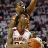 Oklahoma\'s Amath M\'Baye (22) drives the ball against Texas\' Jonathan Holmes (10) during a men\'s college basketball game between the University of Oklahoma (OU) and the University of Texas at the Lloyd Noble Center in Norman, Okla., Monday, Jan. 21, 2013. Photo by Nate Billings, The Oklahoman