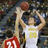 Arnett\'s Tyler Tune shoots over Big Pasture\'s Cameron Smith during the Class B Boys semi-final game of the state high school basketball tournament between Big Pasture and Arnett at the State Fair Arena., Friday, March 1, 2013. Photo by Sarah Phipps, The Oklahoman