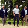 FILE - In this Aug. 23, 2004 file photo, President Goerge W. Bush, center, walks out with, from left to right, National Security Adviser Condoleezza Rice, Vice President Dick Cheney, Secretary of Defense Donald Rumsfeld, and Joint Chiefs Chairman Richard Myers followed by Bush\'s dog Barney, after their meeting on Bush\'s ranch Monday, Aug. 23, 2004, in Crawford, Texas. Barney, former White House Scottish Terrier and star of holiday videos shot during President George W. Bush's administration, has died after suffering from cancer, the former president announced in a statement Friday, Feb. 1, 2013. He was 12. (AP Photo/Pablo Martinez Monsivais, File)