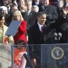 President Barack Obama, first lady Michelle Obama and their daughters, Malia, right, and Sasha, wave after Obama was sworn in at the U.S. Capitol in Washington, Tuesday, Jan. 20, 2009. (AP Photo/Ron Edmonds)