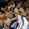 Memphis\' Marc Gasol (33) works against Oklahoma City\'s Serge Ibaka (9) in the first half during an NBA basketball game between the Oklahoma City Thunder and the Memphis Grizzlies at Chesapeake Energy Arena in Oklahoma City, Monday, Feb. 3, 2014. Photo by Nate Billings, The Oklahoman