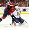 Photo - Washington Capitals right wing Troy Brouwer (20) fights for the puck against Florida Panthers center Jonathan Huberdeau (11) during the second period of an NHL hockey game, Saturday, Feb. 9, 2013, in Washington. (AP Photo/Nick Wass)