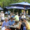 Photo - Crowds begin to gather at the Connecticut open tennis tournament in New Haven, Conn., on Saturday, Aug. 23, 2014. Attendance was up at the tournament for the first time since 2005.  (AP Photo/Fred Beckham)