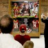 A crowd gathers around a trophy case honoring University of Oklahoma quarterback Sam Bradford after a ceremony to honor Bradford and retire his jersey at Putnam City North High School in Oklahoma City, Friday, April 24, 2009. Photo by Bryan Terry, The Oklahoman