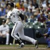 Photo - Milwaukee Brewers' Ryan Braun (8) watches his two-run home run against the Chicago Cubs in the first inning of a baseball game on Sunday, June 1, 2014, in Milwaukee. (AP Photo/Jeffrey Phelps)