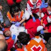 Photo - Medical assistants help a participant injured during the running of the bulls with ''Torrestrella'' fighting bulls, at the San Fermin festival, in Pamplona, Spain, Monday, July 7, 2014. Revelers from around the world arrive to Pamplona every year to take part in some of the eight days of the running of the bulls glorified by Ernest Hemingway's 1926 novel