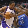 Phoenix Suns forward Channing Frye drives against Oklahoma City Thunder forward Kevin Durant (35) during the second half of an NBA basketball game, Wednesday, April 18, 2012, in Phoenix. (AP Photo/Matt York) ORG XMIT: PNU110