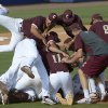 Photo - College of Charleston players celebrate on the field after their 4-2 win over Long Beach State in an NCAA college baseball regional tournament game in Gainesville, Fla., Monday, June 2, 2014.(AP Photo/Phelan M. Ebenhack)