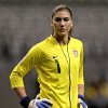 Photo -   FILE - In this Jan. 20, 2012, file photo, United States goalkeeper Hope Solo (1) reacts during the first half of a CONCACAF women's Olympic qualifying soccer match against the Dominican Republic in Vancouver, British Columbia. Police in Kirkland, Wash., say former NFL football player Jerramy Stevens appeared in court Tuesday, Nov. 13, 2012, after being arrested hours earlier on suspicion of domestic violence assault. The Seattlepi.com reported that a Kirkland Municipal judge released Stevens saying there was no evidence connecting him to any assault. Stevens and Hope Solo applied for a marriage license last Thursday, according to King County records. (AP Photo/The Canadian Press, Jonathan Hayward, File)