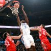 Oklahoma City\'s Serge Ibaka shoots in front of pressure from Houston\'s Brad Miller and Kevin Martin during their NBA basketball game at the OKC Arena in downtown Oklahoma City on Wednesday, Nov. 17, 2010. Photo by John Clanton, The Oklahoman