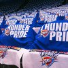 Photo - Blue t-shirts and white towels cover the seats Saturday in the Oklahoma City Arena before the start of Game 3. Chris Landesberger, The Oklahoman