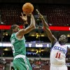 Photo -   Boston Celtics' Rajon Rondo (9) shoot over Philadelphia 76ers' Jrue Holiday (11) in the first half of an NBA preseason basketball game, Monday Oct. 15, 2012, in Philadelphia. (AP Photo/H. Rumph Jr)