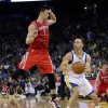 Golden State Warriors\' Stephen Curry, right, looks to shoot as Houston Rockets\' Jeremy Lin (7) defends during the second half of an NBA basketball game in Oakland, Calif., Tuesday, Feb. 12, 2013. Houston won 116-107. (AP Photo/Marcio Jose Sanchez)