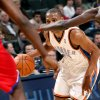 Oklahoma City\'s Russell Westbrook looks through the Philadelphia defense during the first half of their NBA basketball game at the Ford Center in Oklahoma City on Tuesday, Dec. 2, 2009. By John Clanton, The Oklahoman