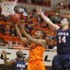 Oklahoma State\'s Le\'Bryan Nash (2) goes between Texas-San Antonio\'s Sei Paye (4) and Texas-San Antonio\'s Alex Vouyoukas (14) during an NCAA college basketball game between the Oklahoma State University Cowboys (OSU) and the University of Texas-San Antonio Roadrunners at Gallagher-Iba Arena in Stillwater, Okla., Wednesday, Nov. 16, 2011. Photo by Bryan Terry, The Oklahoman
