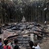 People look at a Buddhist temple which was torched in an overnight weekend attack in Ramu in the coastal district of Cox\'s Bazar, Bangladesh, Tuesday, Oct. 2, 2012. About 1,000 Buddhist families fled their villages after rioters burned at least 10 Buddhist temples and 40 homes and looted shops in anger over a Facebook photo of a burned Quran. Authorities in Bangladesh have ordered security officials to remain alert around official camps of Rohingya Muslims following the attacks.(AP Photo/A.M.Ahad)