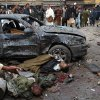 EDS NOTE: GRAPHIC CONTENT - The bodies of two dead men lie in the street at the site of a bomb blast that targeted paramilitary soldiers in a commercial area of Quetta, Pakistan, killing at least 12 people and wounding more than 40 others, according to police, Thursday, Jan. 10, 2013. A series of bombings in different parts of Pakistan killed 115 people on Thursday in one of the deadliest days in the country in recent years. (AP Photo/Arshad Butt)