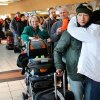 Blizzard conditions in Oklahoma City Thursday, Dec. 24, 2009. Travelers wait in long line to reschedule flights after announcement was made that all flights were cancelled. Photo by Jim Beckel, The Oklahoman