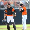 Photo - Oklahoma State catcher Bryan Case, left, walks back to his position after talking with Tyler Nurdin, right, his pitcher during the first inning of an NCAA college baseball regional tournament game in Stillwater, Okla., Sunday, June 1, 2014. (AP Photo/Brody Schmidt)