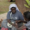 Photo -  Sister Rosemary Nyirumbe visits with a child in Uganda. Photo provided
