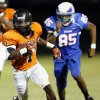 Douglass\' Terry Harris (1) runs away from Millwood\'s Quincy Dotson (85) during the championship high school football scrimmage of the All-City Preview between Douglass and Millwood at Moses F. Miller Stadium in Oklahoma City, Friday, Aug. 24, 2012. Photo by Nate Billings, The Oklahoman