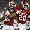 Oklahoma\'s Jamell Fleming (32) and Oklahoma\'s Quinton Carter (20) celebrate after a interception for a touchdown by Fleming during the Fiesta Bowl college football game between the University of Oklahoma Sooners and the University of Connecticut Huskies in Glendale, Ariz., at the University of Phoenix Stadium on Saturday, Jan. 1, 2011. Photo by Bryan Terry, The Oklahoman