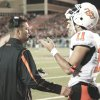 Photo - Mike Gundy talks with Zac Robinson during Saturday's loss. PHOTO By Steve Sisney, The Oklahoman