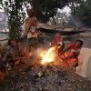 Homeless Indians keep warm around a bonfire on a cold morning in Bhubaneswar, India, Wednesday, Jan. 9, 2013. More than 100 people have died of exposure as parts of the country deal with historically cold temperatures. (AP Photo/Biswaranjan Rout)