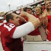 OU quarterback Landry Jones (12) celebrates with fans after the Red River Rivalry college football game between the University of Oklahoma (OU) and the University of Texas (UT) at the Cotton Bowl in Dallas, Saturday, Oct. 13, 2012. OU won, 63-21. Photo by Nate Billings, The Oklahoman