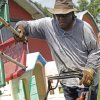 Photo -  Kenneth Tisdale of Tisdale's Lawns & More mows in south Oklahoma City in Tuesday's hot weather. Photo by K.T. King, The Oklahoman  <strong>KT King</strong>