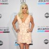 Ke$ha arrives at the 40th Anniversary American Music Awards on Sunday, Nov. 18, 2012, in Los Angeles. (Photo by John Shearer/Invision/AP)