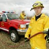 El Reno firefighters Nathan Plagg (left) and Trent Bryan pose for a photo with a brush pumper in El Reno, Okla. Feb. 8, 2008. BY STEVE GOOCH, THE OKLAHOMAN
