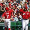 Photo - Washington Nationals' Denard Span (2) celebrates after scoring with teammate Jayson Werth during the third inning of a baseball game against the Chicago Cubs at Nationals Park, Saturday, July 5, 2014, in Washington. (AP Photo/Alex Brandon)