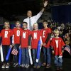 Republican presidential candidate and former Massachusetts Gov. Mitt Romney poses with children wearing shirts which spell out