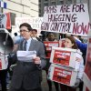 FILE - In this Friday, Dec. 21, 2012 file photo, Josh Nelson, campaign manager, CREDO Mobile, speaks after his group was denied entrance to the Williard InterContinental Hotel where they wanted to deliver a petition to the National Rifle Association calling for the NRA to get out of the way of gun control, as the NRA holds a news conference in Washington. The divide between those who favor gun control and those who don\'t has existed for decades, separating America into hostile camps of conservative vs. liberal, rural vs. urban. As the nation responds to the massacre of 20 children and six adults in Newtown, Conn., the gulf has rarely felt wider than now. (AP Photo/Cliff Owen, File)