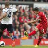 Photo - Liverpool's Philippe Coutinho, right, scores past Tottenham's Younes Kaboul during their English Premier League soccer match at Anfield Stadium, Liverpool, England, Sunday March 30, 2014. (AP Photo/Jon Super)