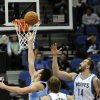 Photo -   Denver Nuggets' Danilo Gallinari, left, of Italy, attempts a layup as Minnesota Timberwolves' Nikola Pekovic, right, of Montenegro, and Andrei Kirilenko, center, of Russia, look on in the first half of an NBA basketball game on Wednesday, Nov. 21, 2012, in St. Paul. (AP Photo/Jim Mone)