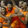 Oklahoma State\'s Michael Cobbins (20), Marcus Smart (33) and Kamari Murphy (21) celebrate a three-pointer from Alex Budke (23) during the men\'s college basketball game between Oklahoma State University and Central Arkansas at Gallagher-Iba Arena in Stillwater, Okla., Sunday,Dec. 16, 2012. Photo by Sarah Phipps, The Oklahoman